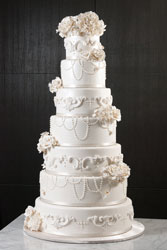seven-tier-round-wedding-cake-white-flowers-peral-drops_