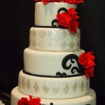 five-tier-round-wedding-cake-white-black-red-flowers-topper