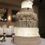 five-tier-round-wedding-cake-white-flowers-lights-crystal-tear-drops