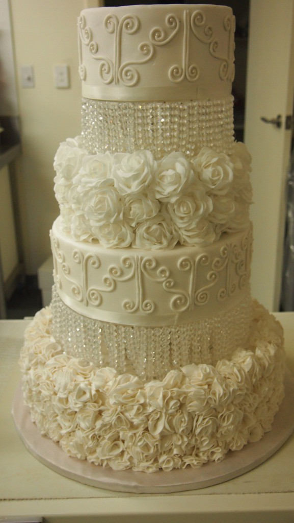 four tier wedding cake with flowers four tier wedding cake white flowers lights crystals 14436