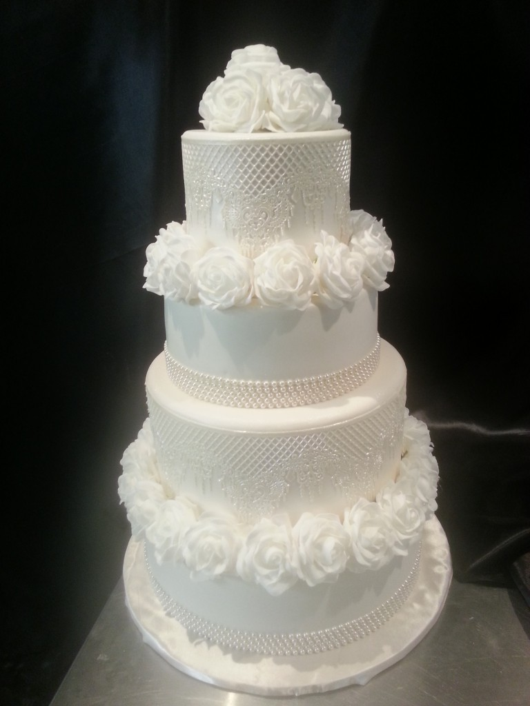 four tier wedding cake with flowers four tier wedding cake white sugar flowers surgar 14436