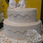 two-tier-circle-engagement-cake-off-white-stencil-bow