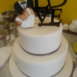 two-tier-circle-engagement-cake-white-stencil-black-love-bride-groom-biscuits