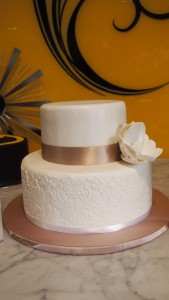 two-tier-circle-engagement-cake-white-stencil-bronze