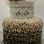 two-tier-double-height-circle-engagement-cake-white-brown-ruffles