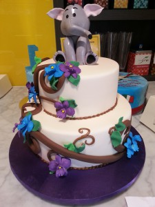 two-tier-round-birthday-cake-elephant-flowers